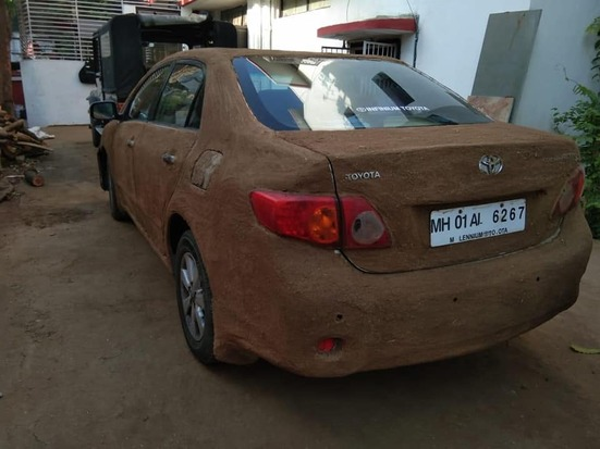 Viral Pics: This Car Owner Coats His Car With Cow Dung To Keep It Cool!